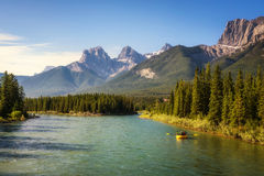 Rafting on the Bow River near Canmore in Canada. Rafting on the Bow River in Banff National Park near Canmore in the Summer, Canadian Rockies, Alberta, Canada Stock Photo