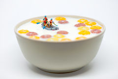 Rafting in a bowl of colorful cereal with milk. Healthy breakfas Royalty Free Stock Photo