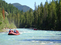 Rafting in British Columbia mountains. A raft floats on Toby Creek on contrasting blue waters in eastern British Columbia in the Purcell Mountains royalty free stock photography
