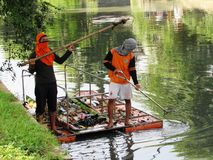 Rafting cleanup on Jakarta canal. Cleaning up on raft on Jakarta canal - Indonesia Royalty Free Stock Images