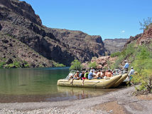 Rafting on Colorado River below Boulder Dam, NV. Image shows a commercial raft on the Colorado River below Boulder (Hoover) Dam.This raft travels down a section stock photography