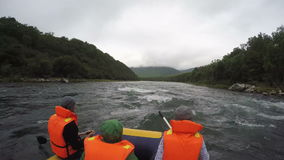 Rafting on Kamchatka Peninsula in gloomy weather stock video