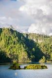 Rafting at Lagos de Montebello lakes, traveling Chiapas, Mexico. Saling Montebello, Mexico Lake at Chiapas. Green jungle hills Royalty Free Stock Photo