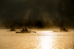 Rafting in the lake in morning mist. Tourist on bamboo raft in the morning mist and beautiful light Stock Photography