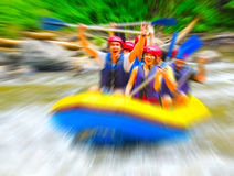Rafting on mountain river, blurred in postproduction Royalty Free Stock Photo