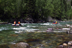 Rafting. People float on a kayak on the mountain river stock photos