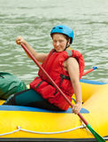 Rafting on the raft. Girl with a paddle on the raft Stock Image