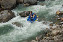 Rafting in a river in Nepal. Rafting is one of many outdoor activities available in Nepal for tourists royalty free stock images
