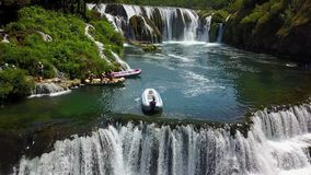 Rafting on the river Una. Štrbački buk is a 24 m high waterfall on the river Uni near the village of Kulen Vakuf and Orašac, which is located near the border Royalty Free Stock Images