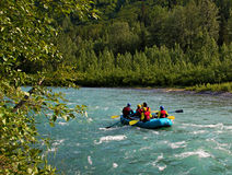 Rafting on Sixmile Creek. Rafting on whitewater in Sixmile Creek near Hope, Alaska on a sunny summer day Stock Photo