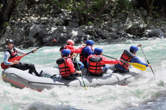 Rafting, splashing the white water Stock Images