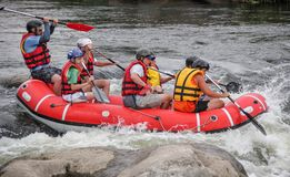 Rafting team , summer extreme water sport. stock photography
