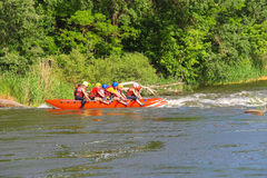 Rafting tourists with an experienced instructor on the river Royalty Free Stock Photos
