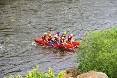 Rafting tourists with an experienced instructor on the river. NIKOLAEV, VILLAGE GRUSHEVKA, UKRAINE - MAY 23, 2014: Rafting tourists with an experienced stock images