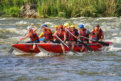 Rafting tourists with an experienced instructor on the river Royalty Free Stock Photo