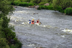 Rafting tourists with an experienced instructor on the river Sou Stock Images
