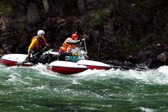 Rafting. Two men float on a kayak on the mountain river royalty free stock photos