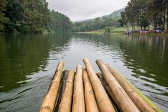 Rafting with wooden raft in the lake of forest hill. Journey in Thailand Stock Photos