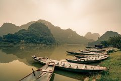 Rafts await villagers by the lake in Vietnam Royalty Free Stock Photography