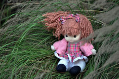 Rag baby. A rag baby is sitting on grasses Stock Photo