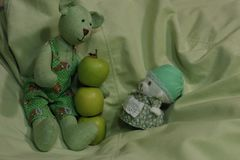 Rag bags and apples on green background sit toys royalty free stock photos