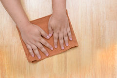 Rag for cleaning. Wooden table Royalty Free Stock Photos
