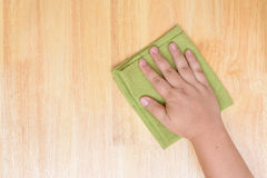 Rag for cleaning. Wooden table Royalty Free Stock Images