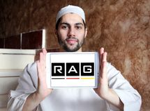 RAG coal mining corporation logo. Logo of RAG coal mining on samsung tablet holded by arab muslim man. RAG AG, formerly Ruhrkohle AG, is the largest German coal Stock Image