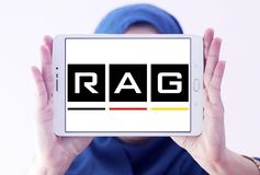 RAG coal mining corporation logo. Logo of RAG coal mining on samsung tablet holded by arab muslim woman. RAG AG, formerly Ruhrkohle AG, is the largest German Stock Photo
