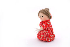 Rag doll. In red dress with coiffured hair standing half-turn on white background Royalty Free Stock Photo