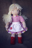 Rag doll. In checkered dress with apron Royalty Free Stock Image