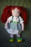Rag doll. Rag redhaired doll in green checkered dress Royalty Free Stock Image