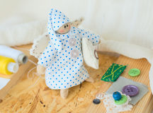 Rag-doll. Funny handmade rag-doll with yarn and needles Royalty Free Stock Photos