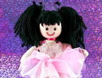 Fabric dolly. A cute rag doll in a party dress Stock Image