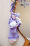 Rag doll hanging on the mirror in room Royalty Free Stock Photo