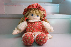Rag doll in red dress Royalty Free Stock Photo