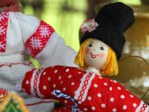 Rag doll russian traditional. Desk at the flea market: handmade rag doll man, in traditional ethnic russian costume Royalty Free Stock Image