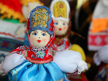 Rag doll russian traditional. Desk at the flea market: handmade rag doll woman, in traditional ethnic russian costume Royalty Free Stock Photo