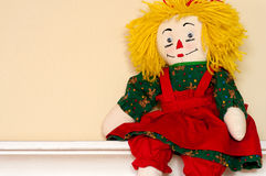 Rag Doll sitting on ledge Stock Photo