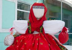 Rag doll on the street is decorated with holiday Maslenitsa.  stock photography