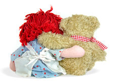 Rag doll and teddy bear hug Stock Images