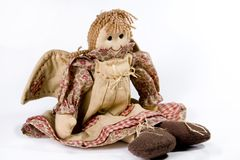 Rag doll with wings. A hand-made rag doll in a pinnafore skirt and wings on her back Stock Photos
