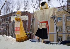 Rag dolls along the street for a holiday Maslenitsa royalty free stock photo