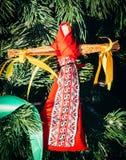 Rag Dolls on christmas tree on folk Slavic pagan holiday Maslenitsa of the end of winter. Rag Dolls on christmas tree on folk Slavic pagan holiday Maslenitsa of stock image