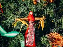 Rag Dolls on christmas tree on folk Slavic pagan holiday Maslenitsa of the end of winter. Rag Dolls on christmas tree on folk Slavic pagan holiday Maslenitsa of stock photography