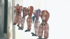 Rag dolls hang in a row on a rope. Rag dolls hang in a row on the rope stock video footage