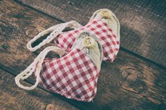Rag hearts on wooden planks Royalty Free Stock Photos