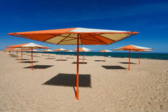 Rag parasols on the sandy beach. And blue sky Royalty Free Stock Photography