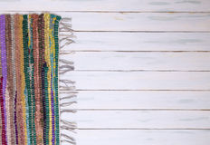 Rag Rug on painted wooden floor Royalty Free Stock Images
