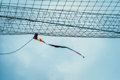 Rag tied to the net blowing in sport field stock images